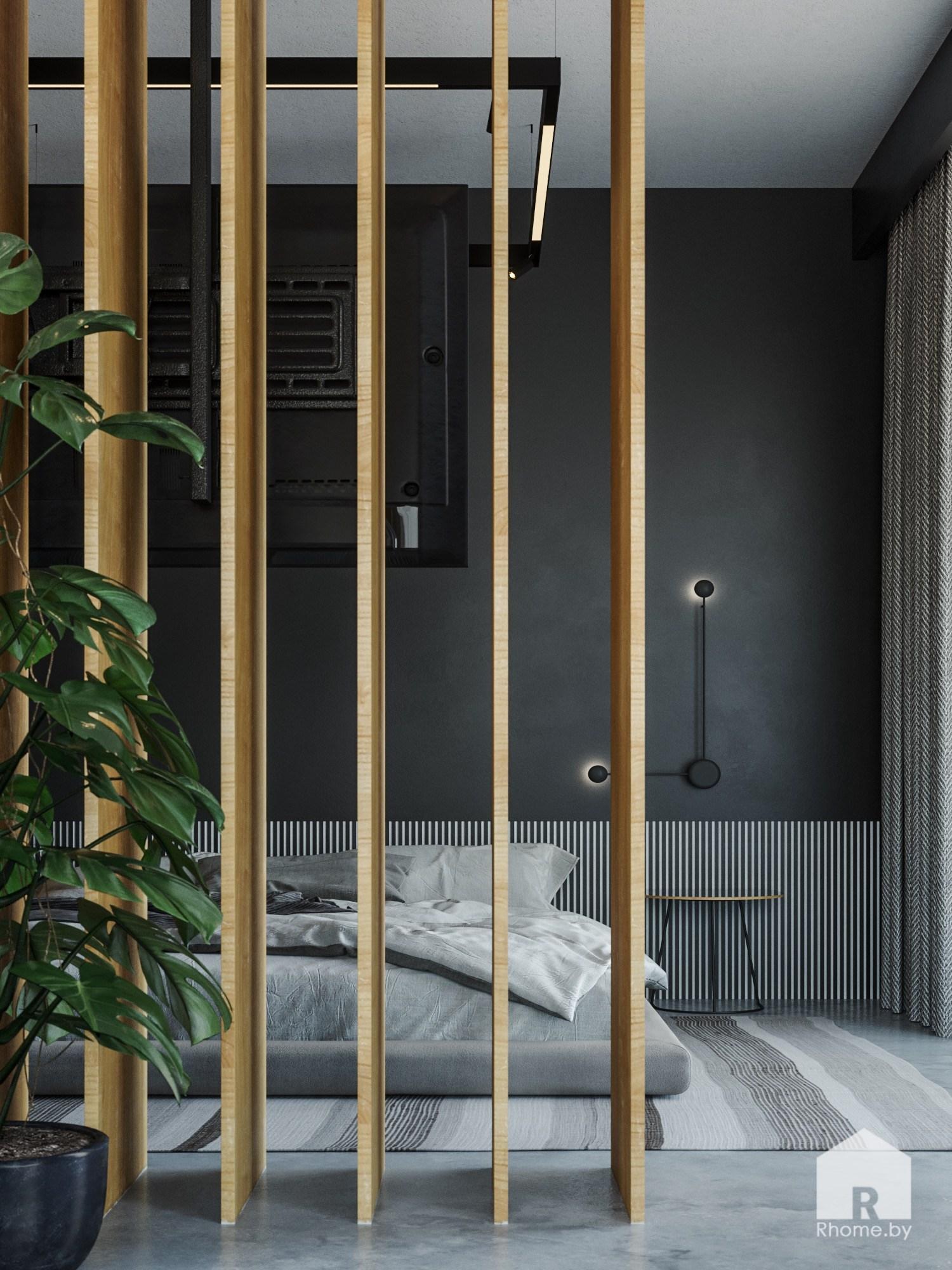Спальная с деревянными реечными перегородками и серой кроватью.