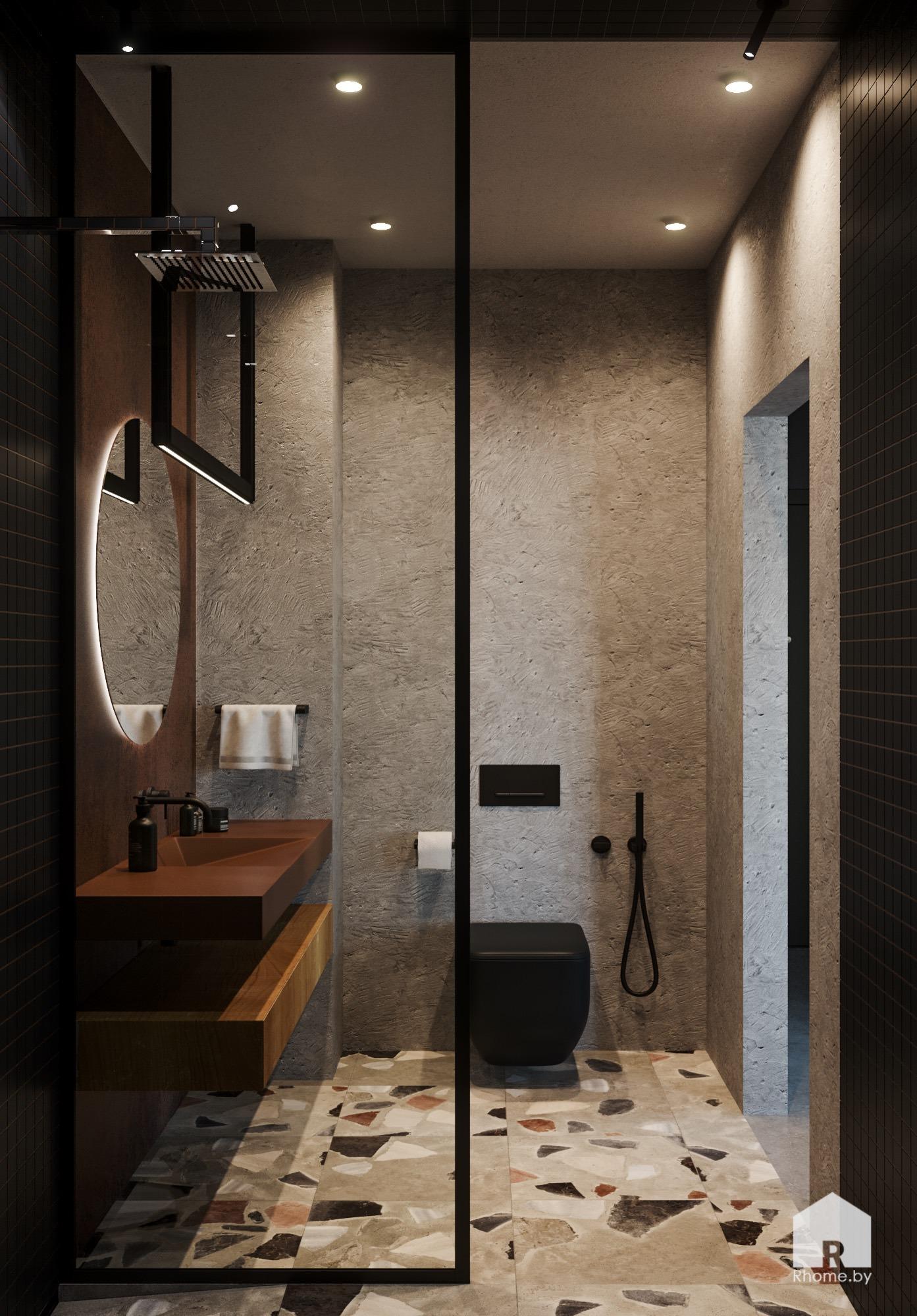 Ванная комната с душевой кабиной, круглым зеркалом с подсветкой и серыми стенами.