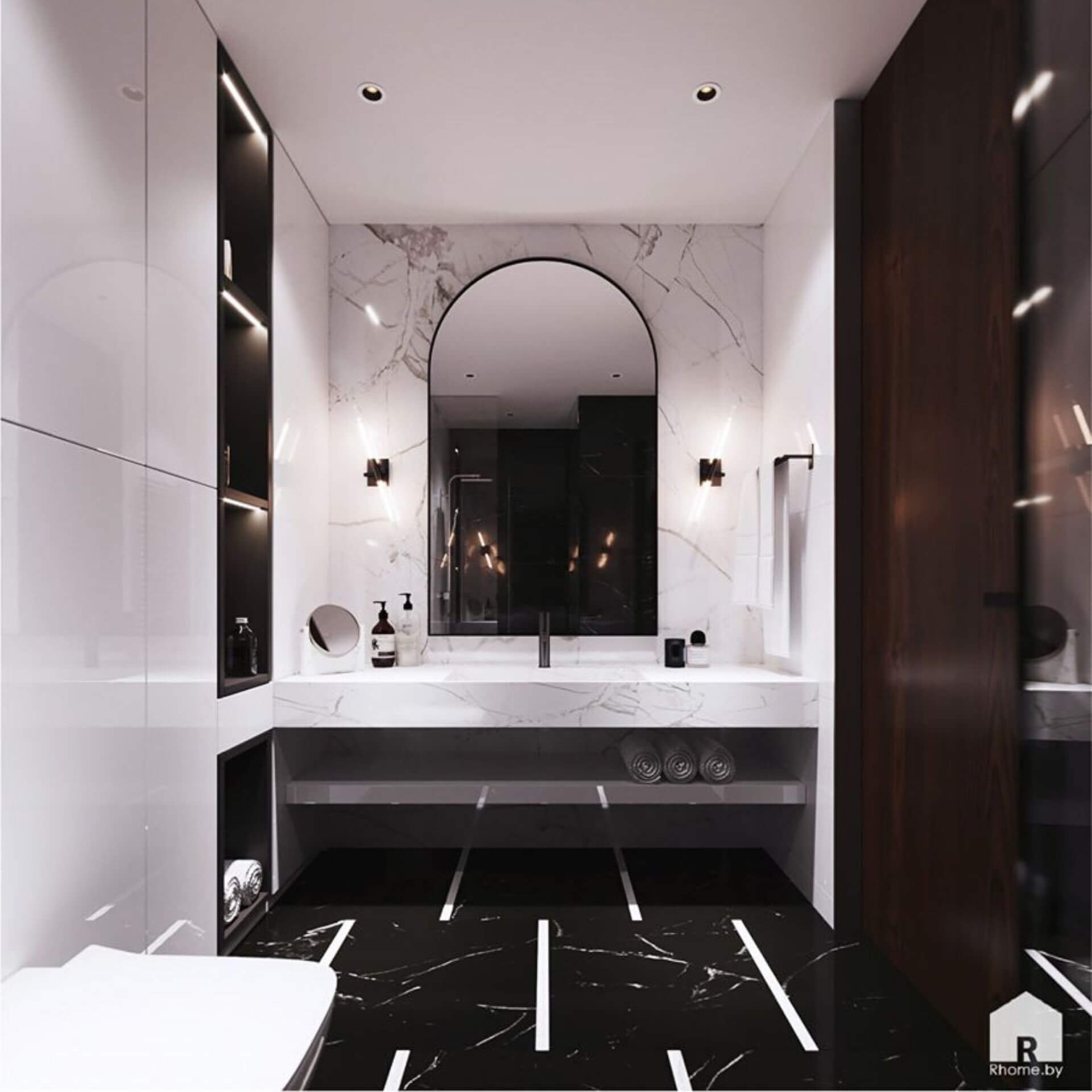 Черно-белая ванная комната с большим зеркалом по центру стены.