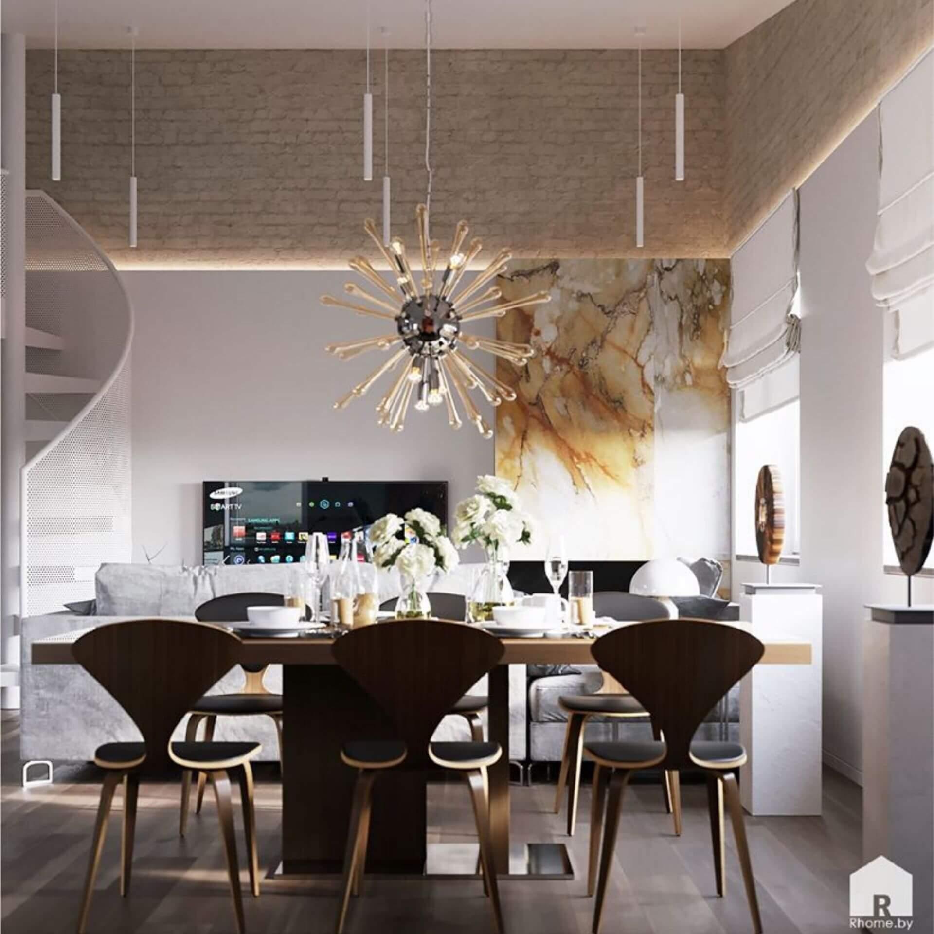Аванградная светлая столовая с необычной люстрой над столом, у которого стоят дизайнерские стулья.