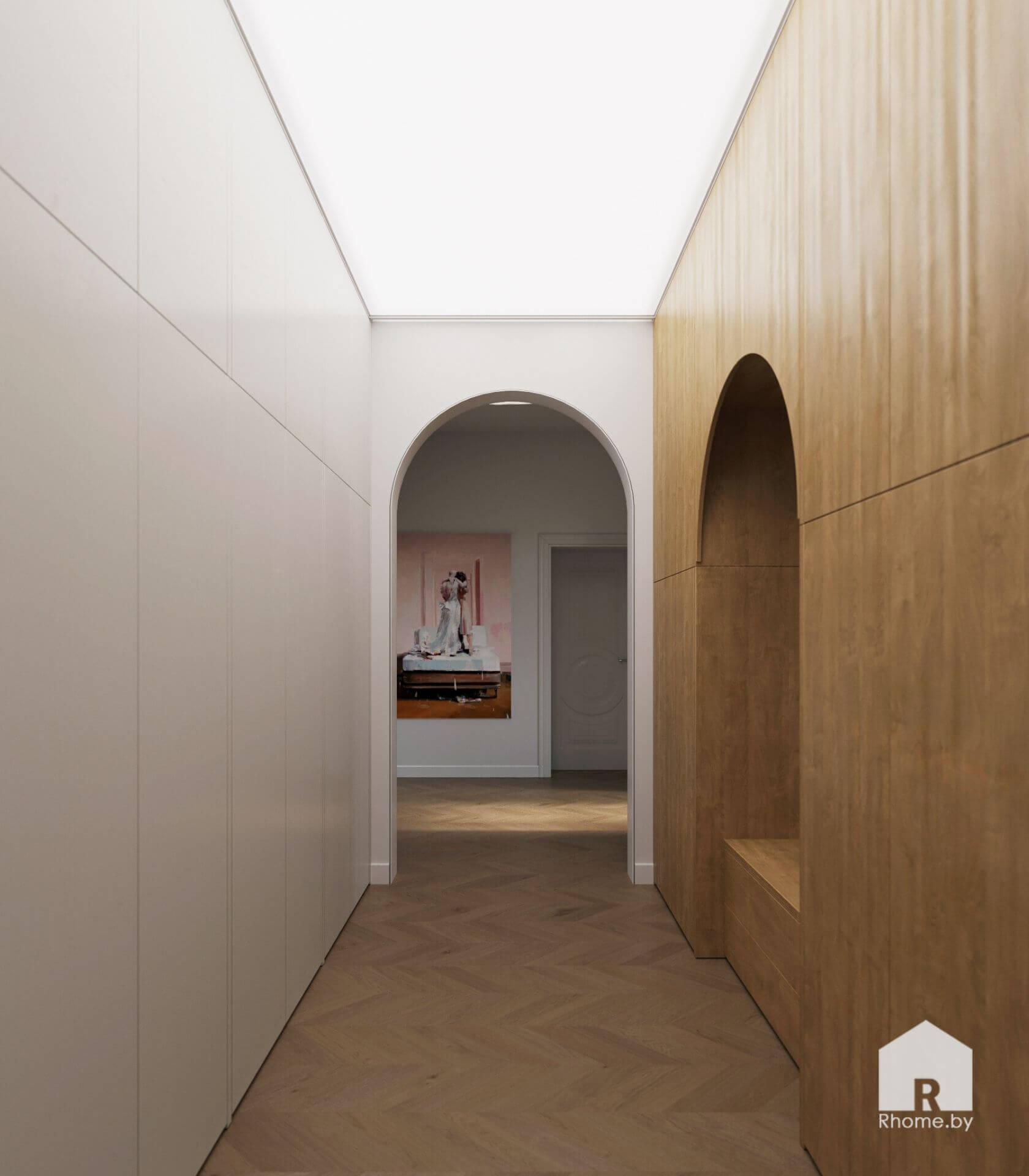 Светлый коридор с аркой, белой стеной, деревянным полом и стеной.