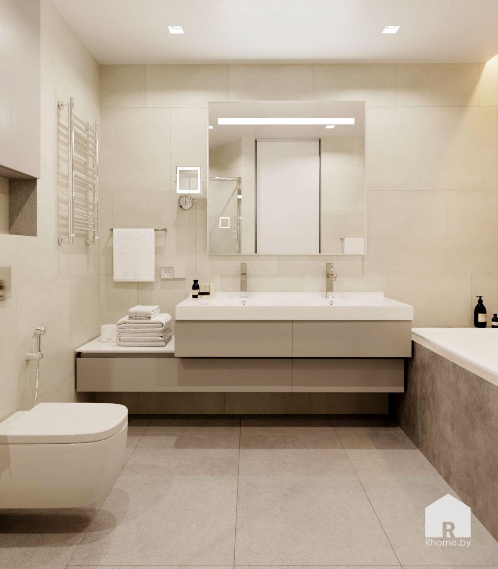 Ванная комната облицованная плиткой под камень, в центре тумба под умывальник и зеркало